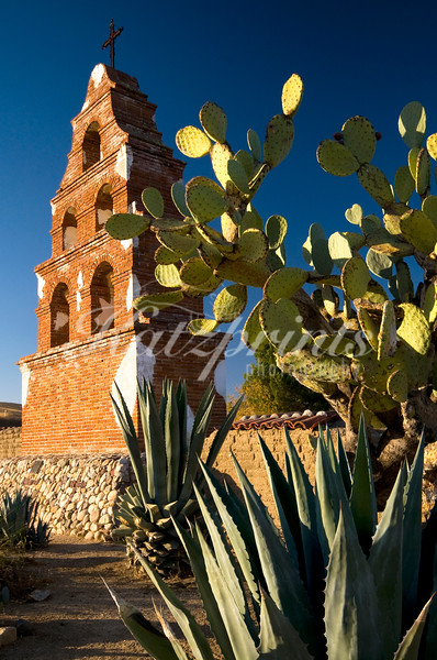 """Campanile of Mission San Miguel Arcángel (founded 1797) in San Miguel, the only mission that still displays the original, unaltered pictures and colors painted by Indian artisans in 1820. <a href=""""http://www.missionscalifornia.com/keyfacts/san-miguel-arcangel.html"""" target=""""blank"""">more</a>"""