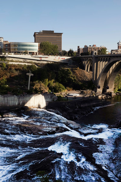 In this slow shutter speed photograph the Spokane Falls are seen from the north near W. Bridge Ave., Saturday, July 24, 2021, in Spokane, Wash. (Young Kwak)
