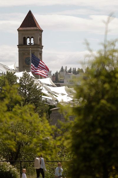 The Pavilion and Great Northern Clocktower at Riverfront Park are seen as pedestrians walk through the park, in Spokane, Wash., Friday, May 21, 2021. (Young Kwak)