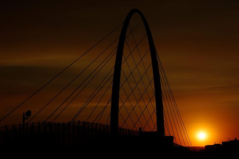 The University District Gateway Bridge is photographed at sunset, Sunday, July 18, 2021, in Spokane, Wash. (Young Kwak)