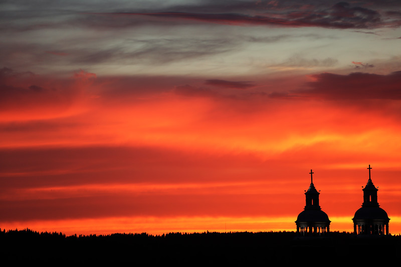The sunset is photographed from the roof of the Davenport Hotel parking structure in Spokane, Wash., Saturday, June 3, 2017. (Young Kwak)