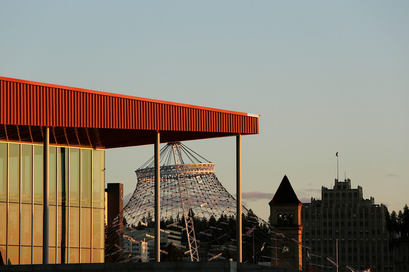 The Podium, front, Pavillion and clock tower at Riverfront Park, and downtown Spokane, Wash., are photographed, Thursday, March 11, 2021. (Young Kwak)