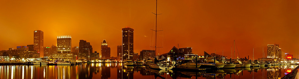Baltimore Inner Harbor, New Year's Eve. Taken on a misty New Year's Eve across from Baltimore's Inner Harbor.  24 vertical images.  All panoramas are $100.00, unmatted. Matted option not available. Posters available in Poster Gallery.  Hover your cursor over the photo to open the menu which allows you to enlarge the photo for easier viewing.