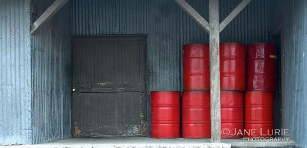 Red Barrels and Warehouse Door, Bozeman, MT