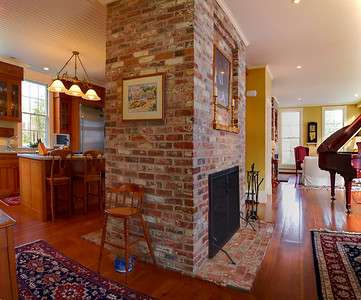 Kitchen to Dining Room transition.  There are fireplaces on either side of this large chimney, both of which work and appear to have been lovingly maintained.