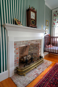 Striped bedroom Fireplace and clock.