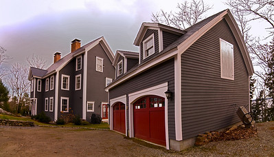 Exterior panoramic shot of the Cape House Garage and the Ross Hall Home.