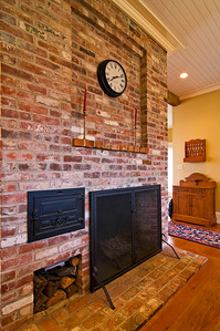 The kitchen fireplace, complete with working beehive oven, and stockpile of well-seasoned wood below.