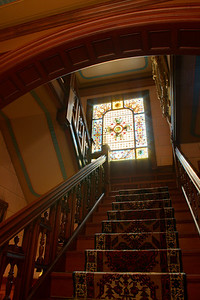 Looking up the grand staircase with the archway overhead.