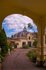 View of the carriage house from under the portico.