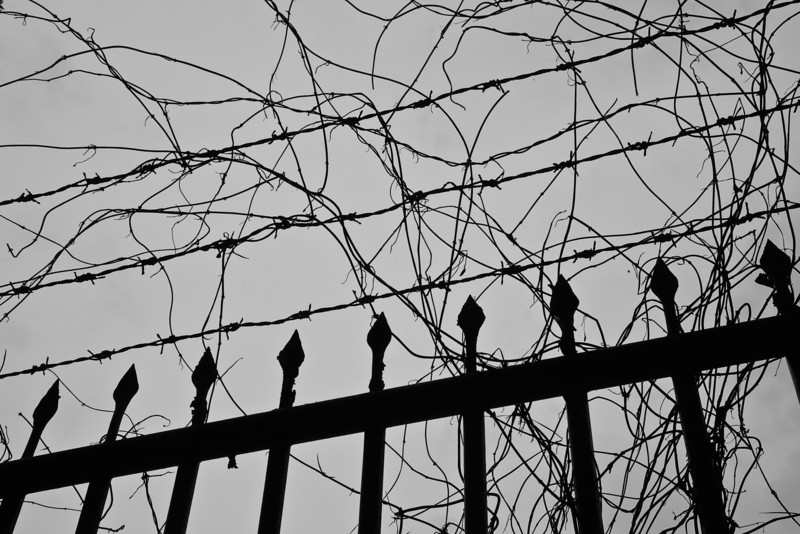 Barb wire fence surrounding the monastery