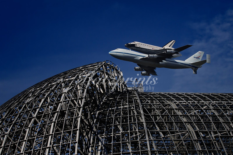 In a historic flyover event on September 21, 2012, the Space Shuttle Endeavour on its 747 carrier aircraft can be seen above Hangar One (itself an awe-inspiring view and one of the world's largest freestanding structures) at Moffett Field, Mountain View, California.