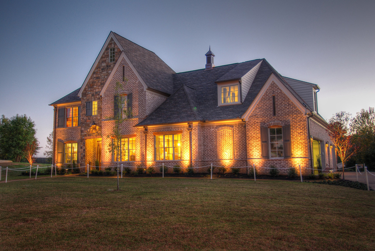 Dusk photo of the exterior of Le Vieux Chene home by Jon Ruch of Ruch Builders featured in the 2012 VESTA Home Show. This photo was taken for a client,  Millennium Home Furnishings and Interiors who designed the interior for the home's debut at VESTA. Photo by Jason R. Terrell.