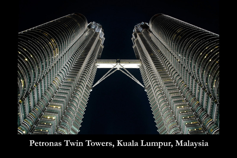 "The 88-storey Petronas Twin Towers, Kuala Lumpur, Malaysia is the world's tallest twin towers. At 58.4 meters is the sky bridge at levels 41 and 42 (floors). This unique double deck sky bridge stands 170 metres above street level and is supported by archs.<br /> <br /> The towers are designed and created by the renowned architect, Cesar Pelli & Associates. The geometric pattern of the islamic heritage was used to design the floor plates. The exterior is a combination of glass and stainless steel.  <a href=""http://www.klcc.com.my"">http://www.klcc.com.my</a>"