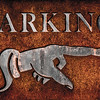 Rusty Vintage Iron Parking Sign Close-up