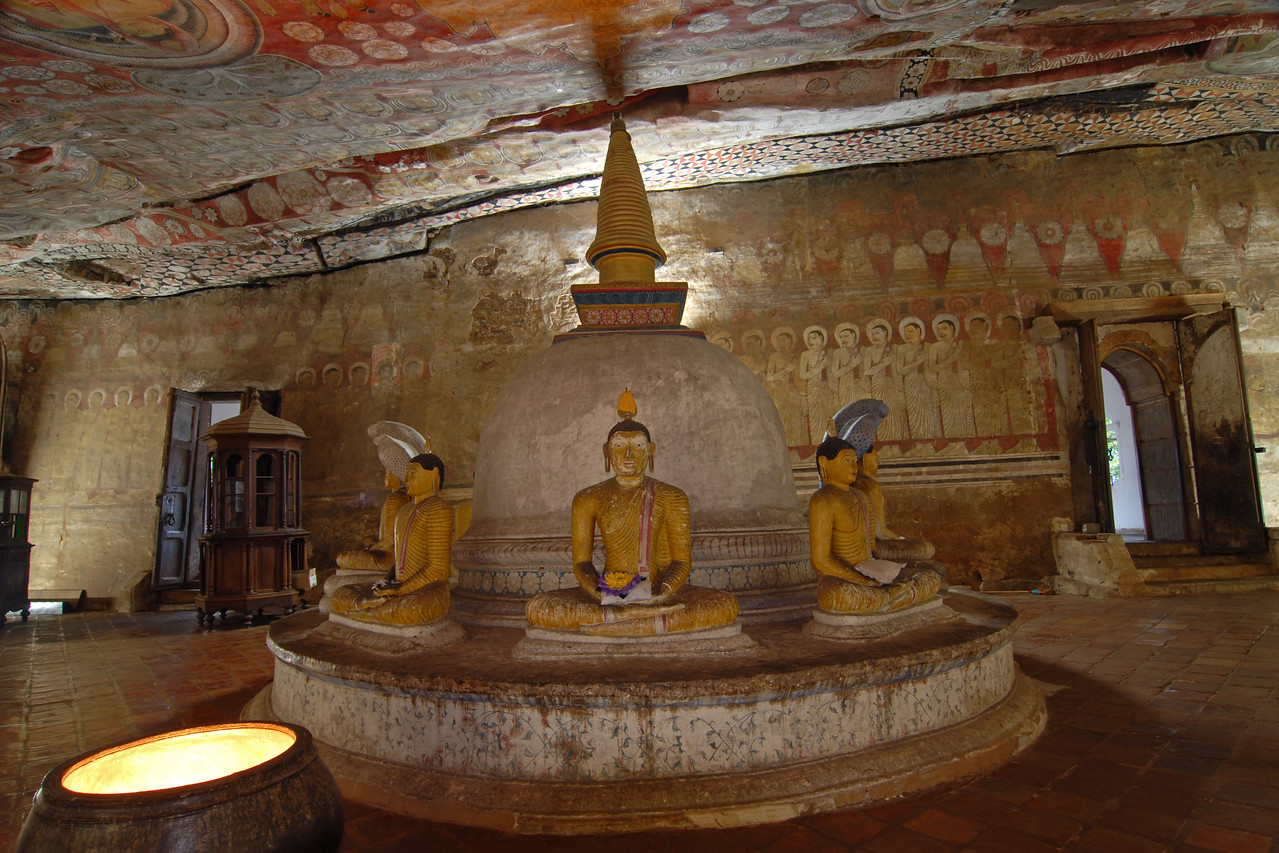 Dambulla Cave Temple (Golden Temple of Dambulla) located not far from Colombo, Sri Lanka is a world heritage site. It is the largest and best-preserved cave temple complex in Sri Lanka. The rock towers 160 m over the surrounding plains.There are more than 80 documented caves in the surrounding. Major attractions are spread over 5 caves, which contain statues and paintings. This paintings and statues are related to Lord Buddha and his life.  Prehistoric Sri Lankans would have lived in these cave complexes before the arrival of Buddhism in Sri Lanka as there are burial sites with human skeletons about 2700 years old ( 700 BC) which have been unearthed in this area at Ibbankatuwa near Dambulla cave complexes.