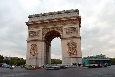 Traffic moves around The Arc de Triomphe which is an iconic structure. Triumphal Arch in Paris, France stands in the centre of the Place Charles de Gaulle, also known as the Place de l'Étoile (Star Square). It is at the western end of the Champs-Élysées. The monument stands 49.5 metres (165 ft) in height, 45 metres (148 ft) wide and 22 meters (72 ft) deep. It is the second largest triumphal arch in existence.