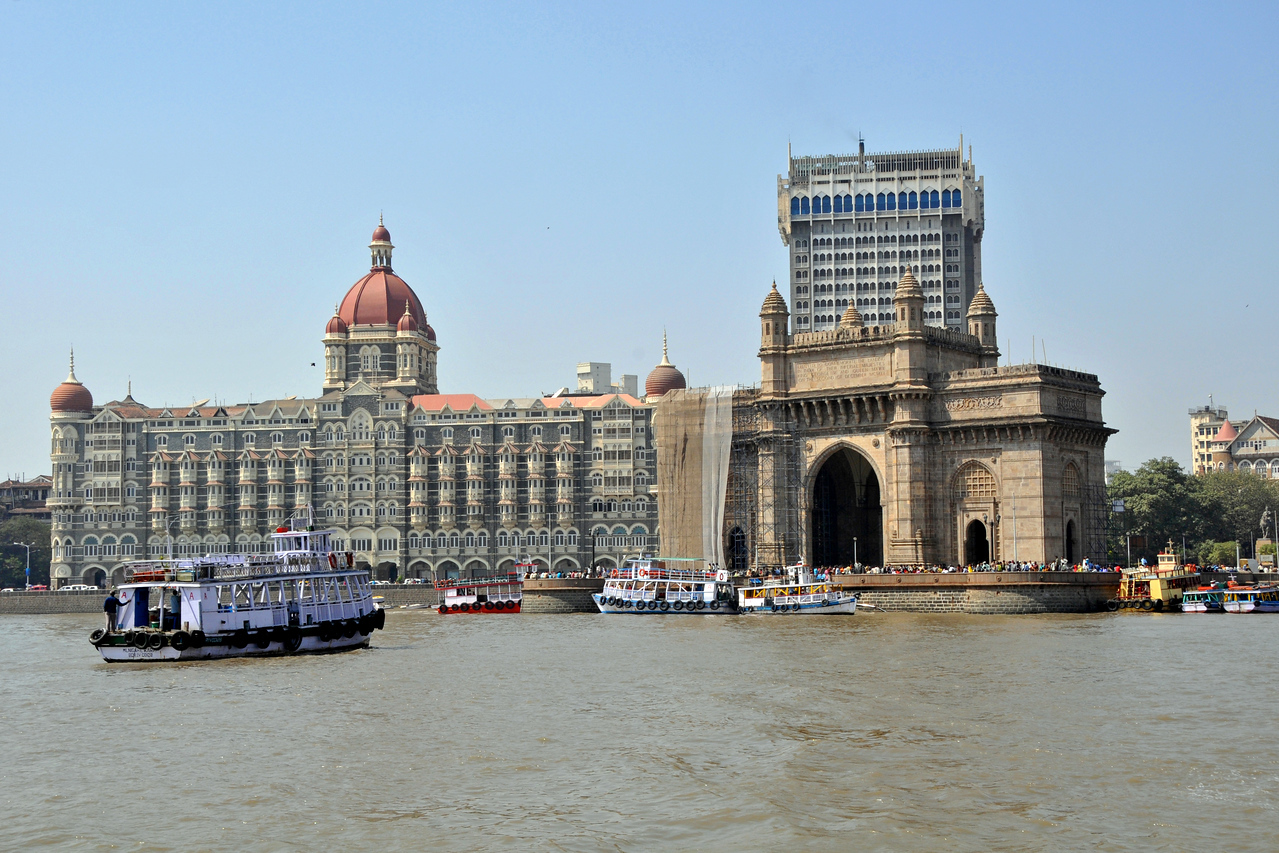 View of Mumbai's Gateway of India with th Hotel Taj at the back. The Elephanta Caves are located just off Mumbai harbour in the Gharapuri Island also called Elephanta Island - a name given by the Portuguese when they ruled over this area. In 1987, the caves were designated a UNESCO World Heritage Site. Hewn out of solid rock, the Elephanta Caves date back to 600 AD. The caves attract many visitors who take an hour long ferry boat ride to reach from Gateway of India. The cave complex is a collection of rock-cut architecture with stone sculptures of Hindu Gods and Goddesses.