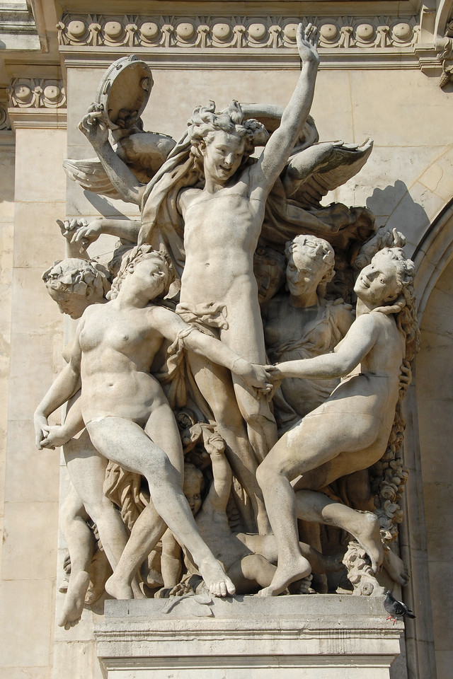 Statues in Paris, France as seen on the wall of The Palais Garnier, also known as the Opéra de Paris or Opéra Garnier or Grand Opera House which is a 2,200-seat opera house in Paris, France. This grand landmark was designed by Charles Garnier in the Neo-Baroque style and it is regarded as one of the architectural masterpieces of its time.<br /> <br /> Upon its inauguration in 1875, the opera house was officially named the Académie Nationale de Musique