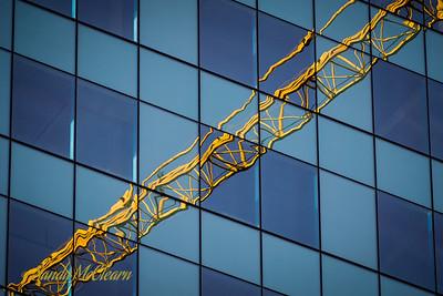 Tower crane reflection on Nova Centre.