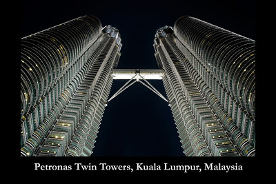 The 88-storey Petronas Twin Towers, Kuala Lumpur, Malaysia is the world's tallest twin towers. At 58.4 meters is the sky bridge at levels 41 and 42 (floors). This unique double deck sky bridge stands 170 metres above street level and is supported by archs.  The towers are designed and created by the renowned architect, Cesar Pelli & Associates. The geometric pattern of the islamic heritage was used to design the floor plates. The exterior is a combination of glass and stainless steel.   http://www.klcc.com.my