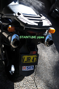 Staintune pipes plus original included free. Givi top box mounting plate also included.