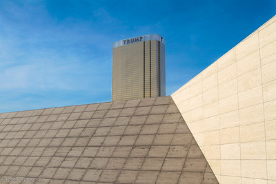 Trump International tower rises above the angled stone facade of the Fashion Show mall.