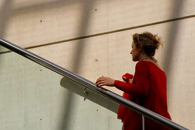 Red gown women walking up staircase was part of a performance piece during the opening of the Linde Family Wing for Contemporary Art. (September 18, 2011)