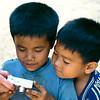 Laos--kids looking at digital photo
