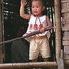 Laos--kid at window
