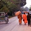 Luang Prabang street scene--monks, tuk tuk