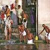 Varanasi, sunrise, men at bathing ghat