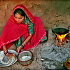 Bishnoi woman making chipatti, village near Jodhpur