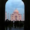 Agra, Taj Mahal viewed through main entrance archway at sunrise