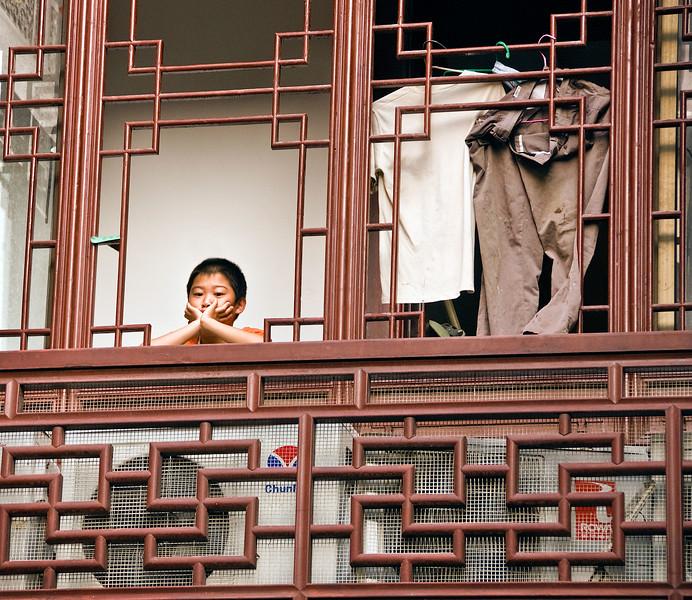 Old City, boy in window