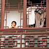 Old City, boy in window