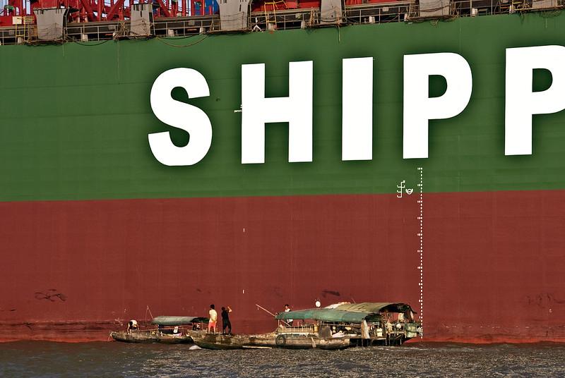 Shanghai, cargo ship and fishermen on Huangpo