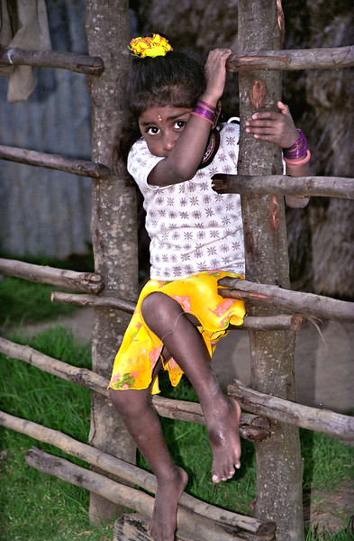 Child on fence, Toda tribal village