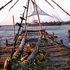 Cochin, Chinese fishing nets, sunset, freighter in background