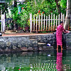Kerala backwaters, woman doing laundry