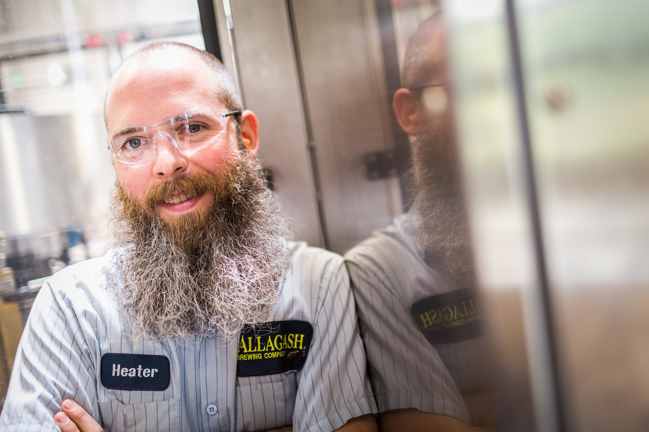 Portrait of a bearded man at work.