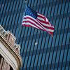 Flag on the Littlefield Building against a skyscraper - Austin, Texas