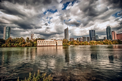 Lady Bird Lake is a major recreation area for the city of Austin. Its banks are bounded by the Lady Bird Lake Hike and Bike Trail, and businesses offer recreational watercraft services along the lakefront portion of the trails. Austin's largest downtown park, Zilker Park, is adjacent to the lake, and Barton Springs, a major attraction for swimmers, flows into the lake. Much of the landscaped beauty of the parks surrounding Lady Bird Lake can be credited to the former First Lady, Lady Bird Johnson, who, in the 1970s, focused her attention on the Town Lake Beautification Project. The City of Austin prohibits operation of most motorized watercraft on Lady Bird Lake. As a result, the lake serves as a popular recreational area for kayaks, canoes, dragon boats, and rowing shells. Austin's warm climate and the river's calm waters, nearly 6 miles (9.7 km) length and straight courses are especially popular with crew teams and clubs.