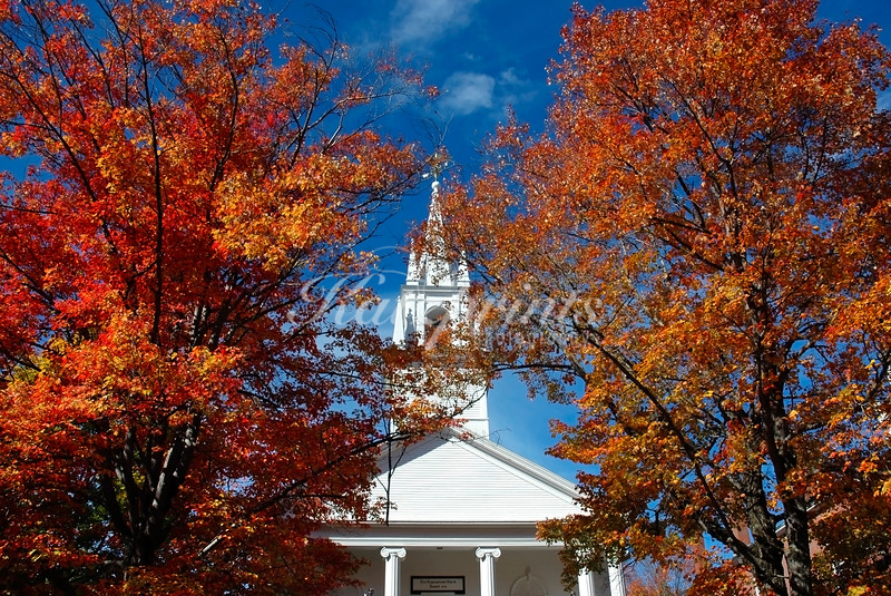 Colorful trees frame the tower of the First Congregational Church (founded in 1773) in Wiscasset, Maine