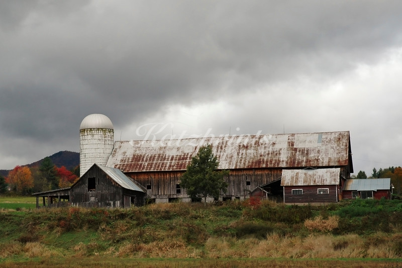 Dark clouds above old Vermont barn