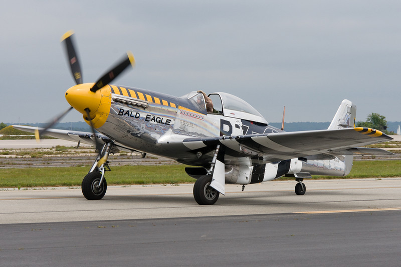 P-51 Bald Eagle taxis by the flight line.