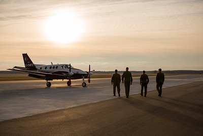 Phase 3 multi pilots walk to C-90B King Air