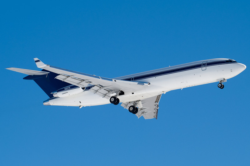 A privately owned 727 with winglets on final for runway 24.