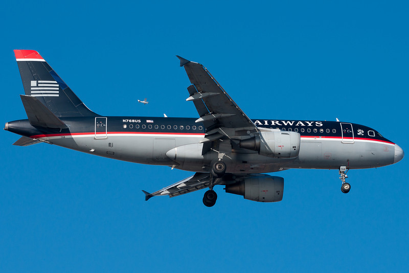 Boston sees a lot of US Airways A319s on a daily basis. There's some VFR traffic visible near the wing.