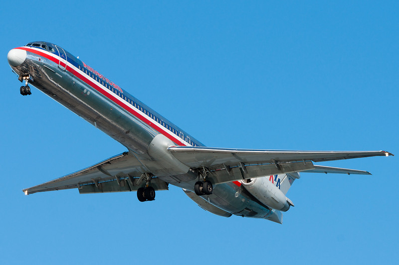 The town of Winthrop is reflected in the fuselage of this American MD-80.